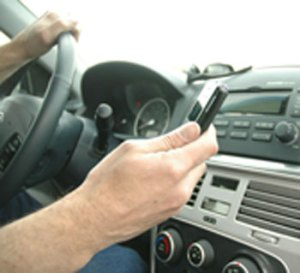 Starting this summer, text messaging or holding your phone to your ear while driving will cost you $124.